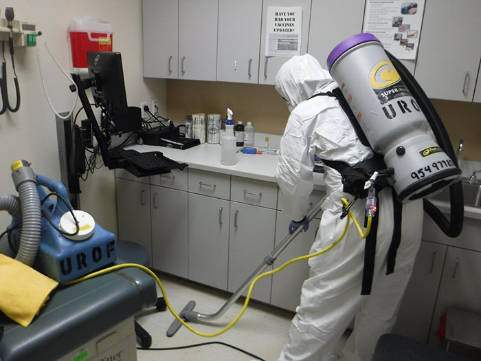 united restoration technician cleaning a biohazard environment in a florida medical center