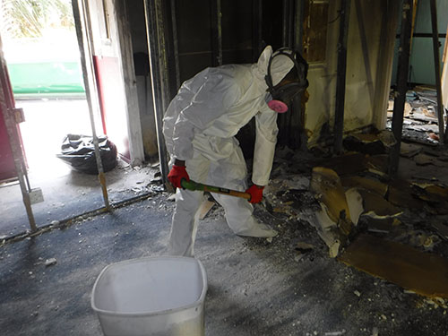 technician cleans fire damage in a church in florida