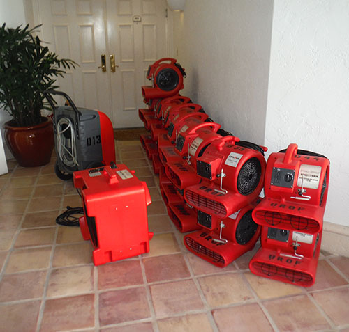 water damage repair equipment outside residential property