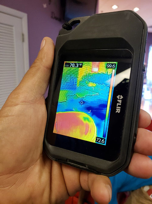 thermal imaging equipment inspecting water damage at florida commercial property