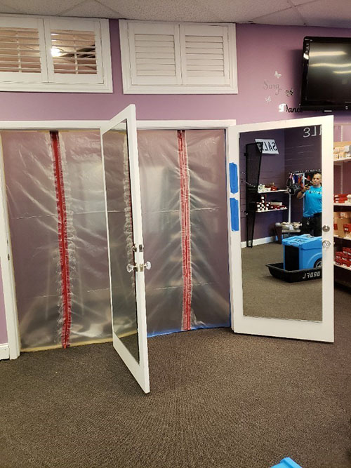 commercial water damage repair containments at retail store in florida