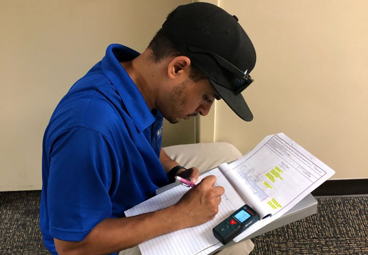 richie assessing water damage at job site