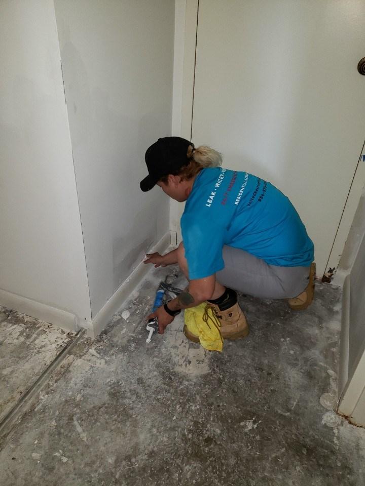 technician repairing emergency water damage in miami