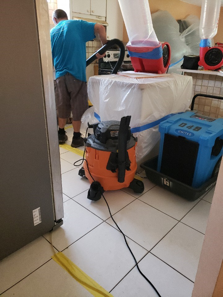 water damage restoration technician at work in aventura florida home