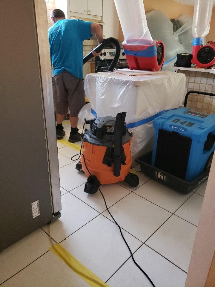 water damage restoration technician at work in aventura florida home