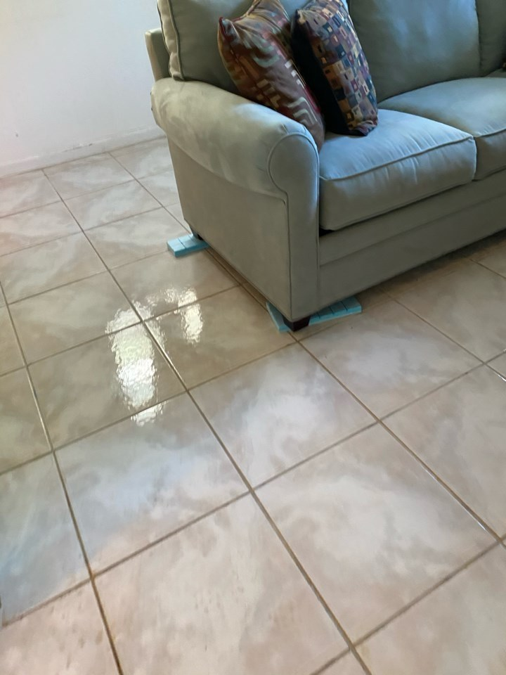 couch elevated during water damage restoration in deerfield beach florida