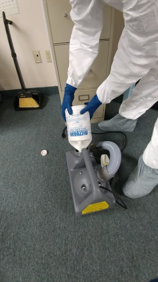 united restoration technician preparing microbial remediation solution for air fogging
