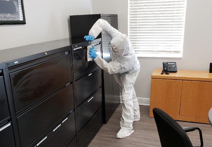 united restoration technician cleaning office space of coronavirus
