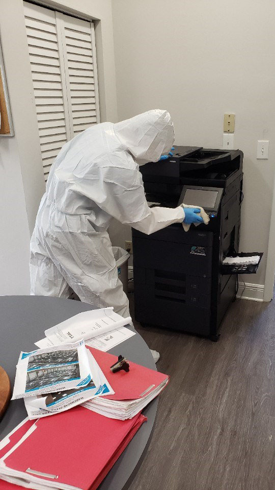 wiping down office equipment for coronavirus