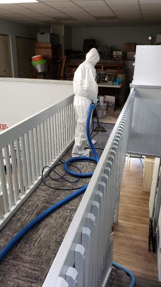 united restoration technician sanitizing carpet for coronavirus