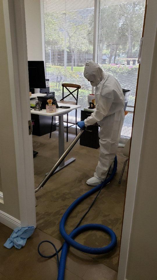 technician sanitizing office space for coronavirus