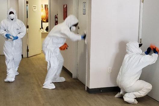 united restoration technicians disinfecting office for coronavirus in florida