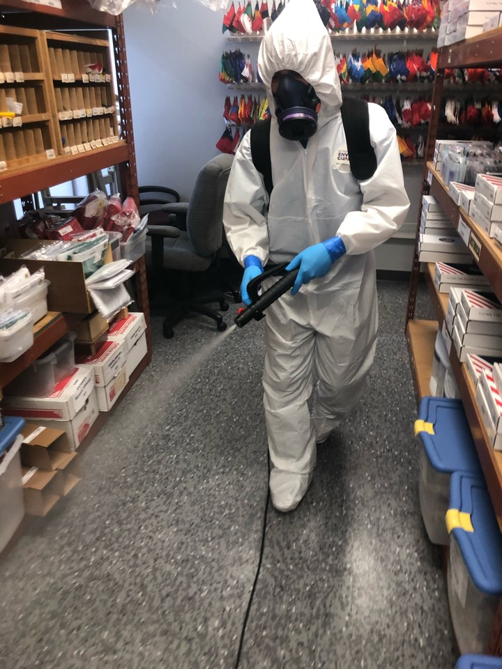 technician fogging office for coronavirus