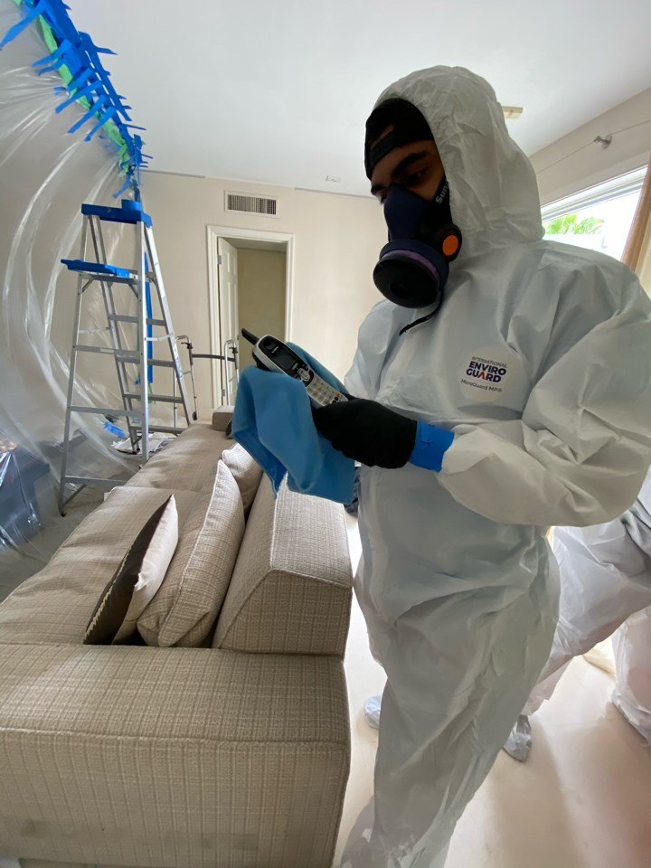 technician cleaning for covid-19 in miami home