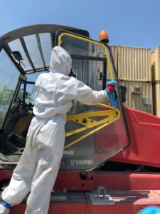 technician wipes down commercial vehicle for coronavirus in miami