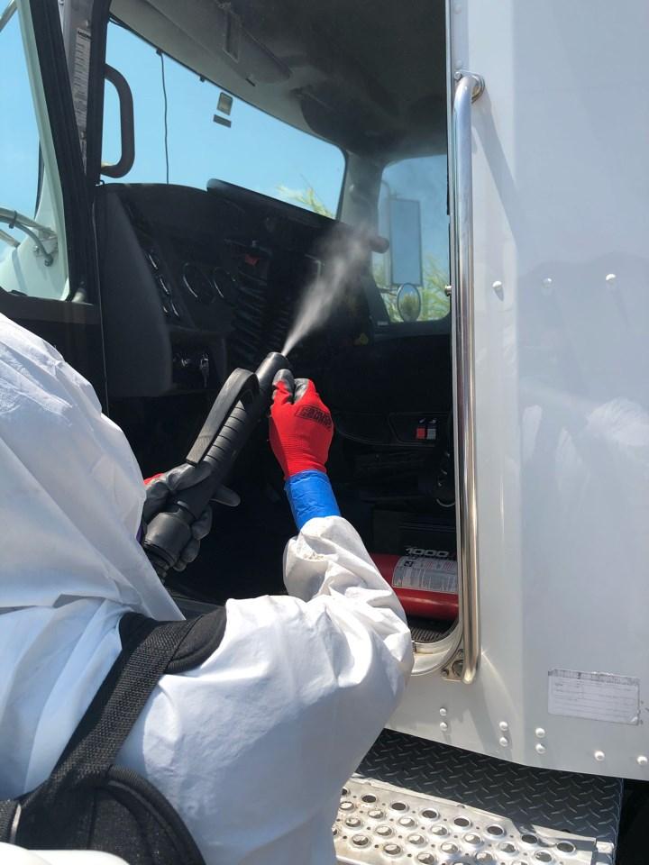 technician fogging commercial property for coronavirus in miami