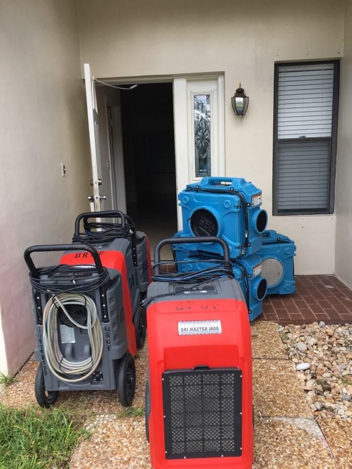water damage restoration equipment outside a boca raton florida home