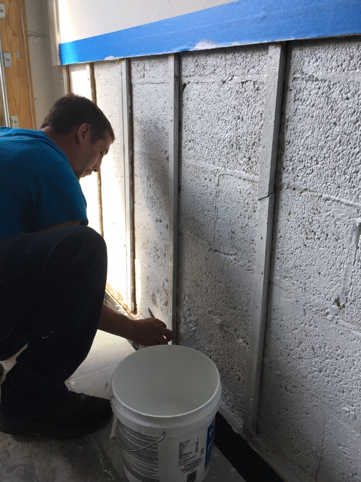 water damage restoration technician at work in oakland park florida