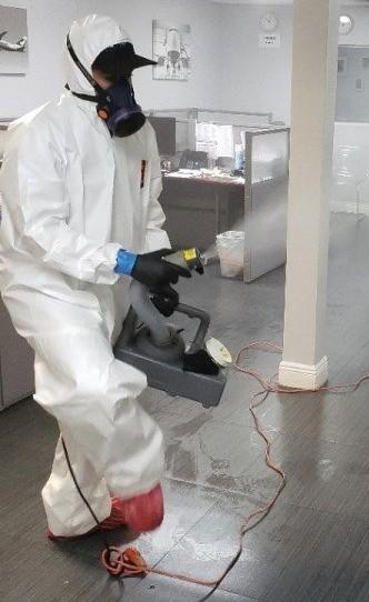 technician fogging for coronavirus in florida office